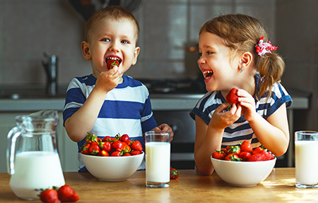 Toddlers Eating Strawberries