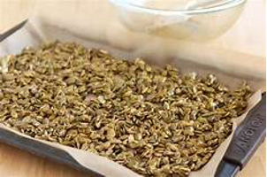 pumpkin seeds on tray ready for roasting